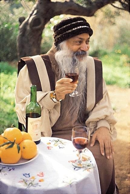 Osho with red whine and oranges