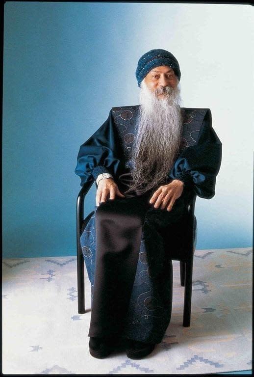 Bhagavan sitting on a chair