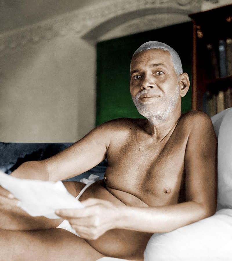 Bhagwan Sri Ramana Maharshi reading